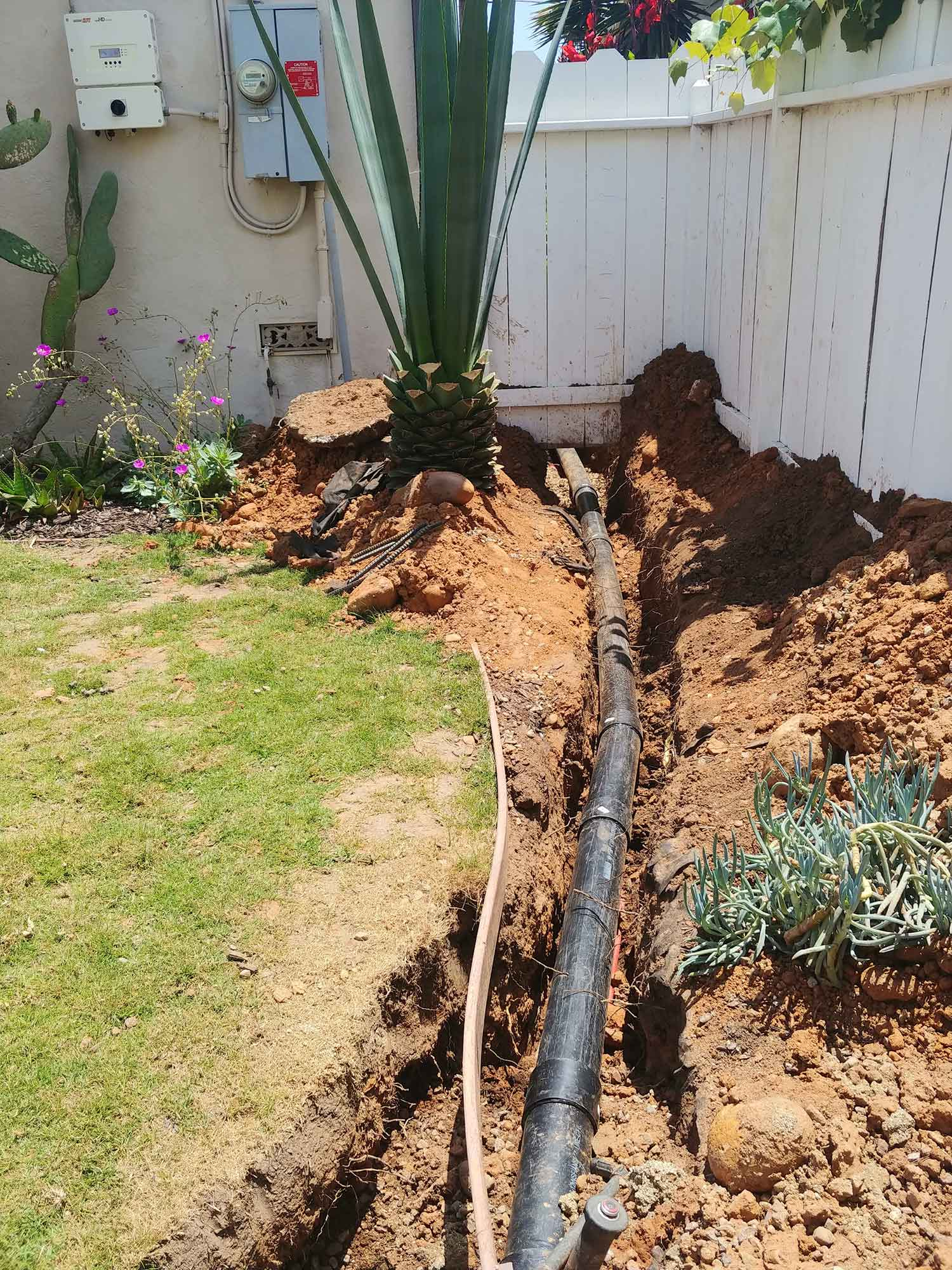 sewer line under fence